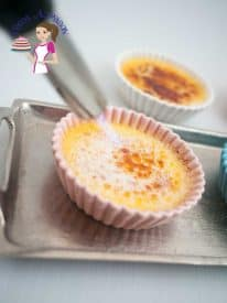 A small twit and you've turned your favorite classic creme brulee into this fruity summer Apricot Creme Brulee. This french dessert is a custard based dessert baked in a water bath then dressed with a glass like caramel. Truly exotic and indulgent.