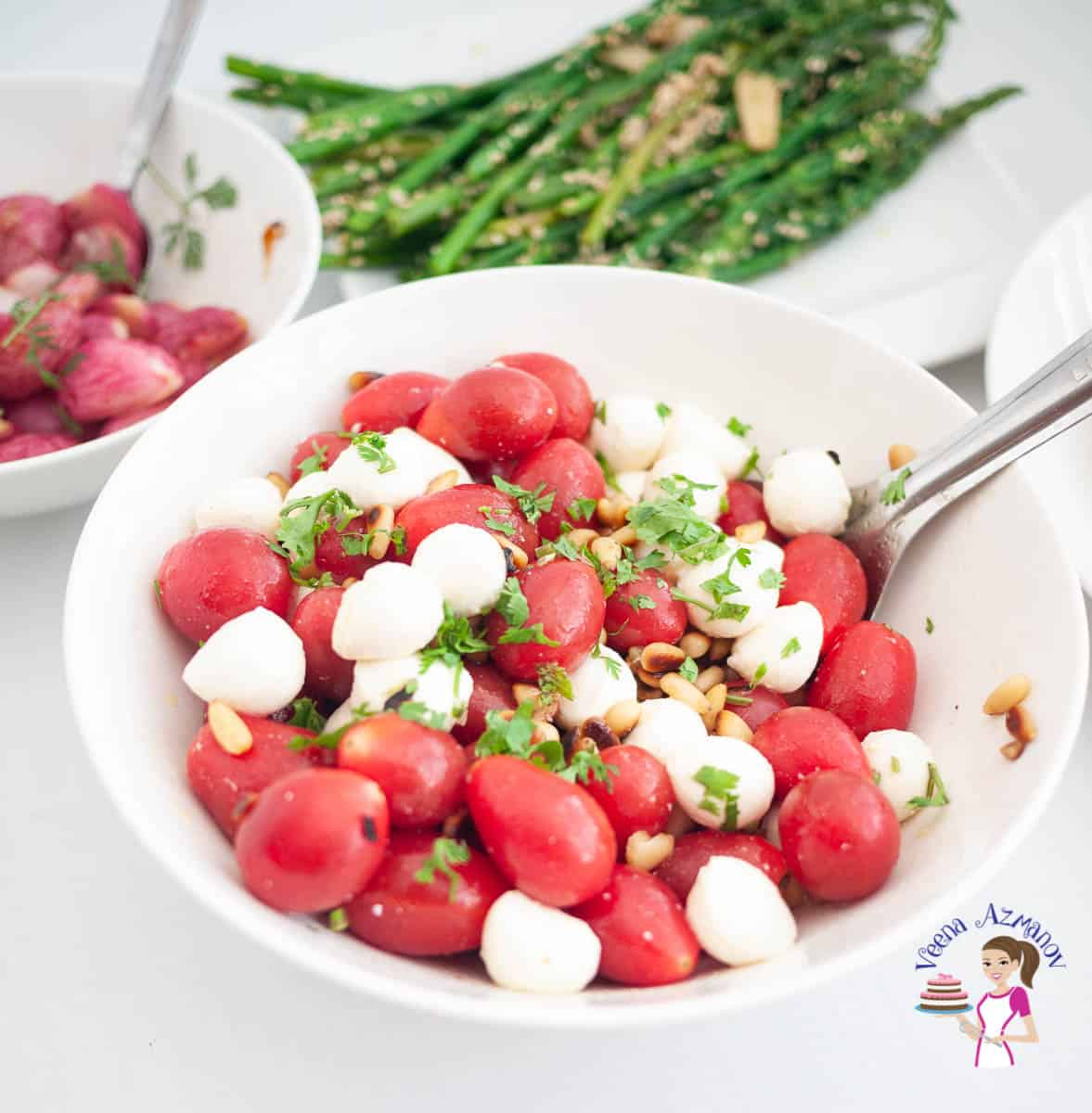 A bowl with tomatoes and mozzarella salad