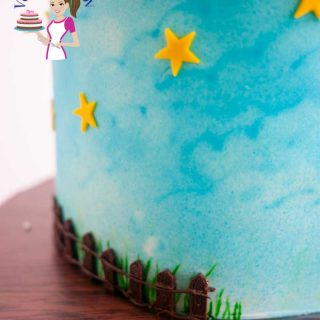 A close up of a cake decorated with stars.