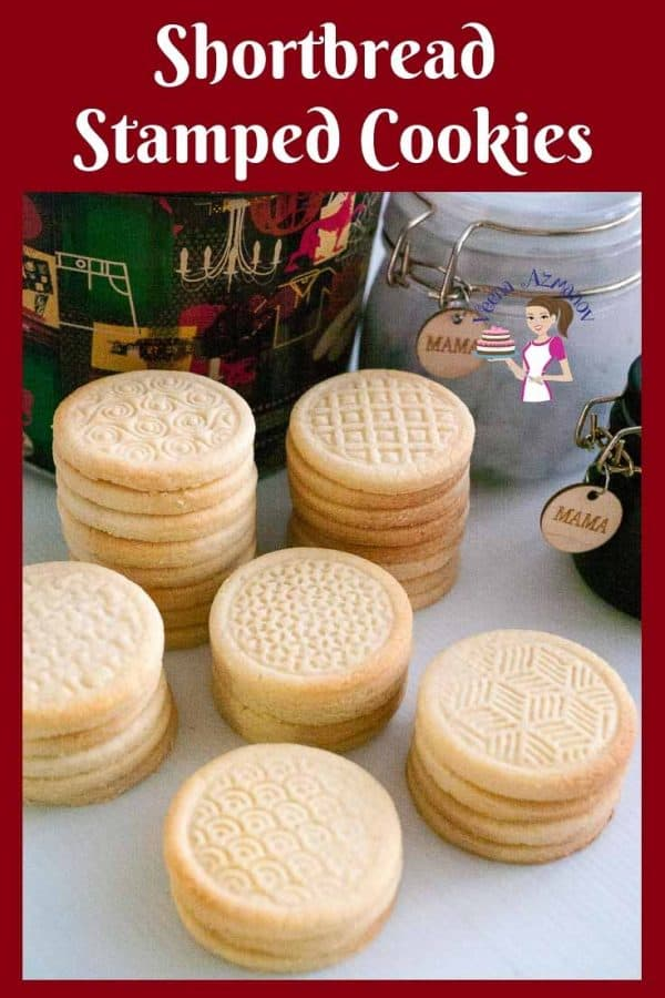 Stacks of stamped shortbread cookies on a table.