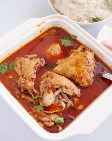 chicken curry  in a serving dish.