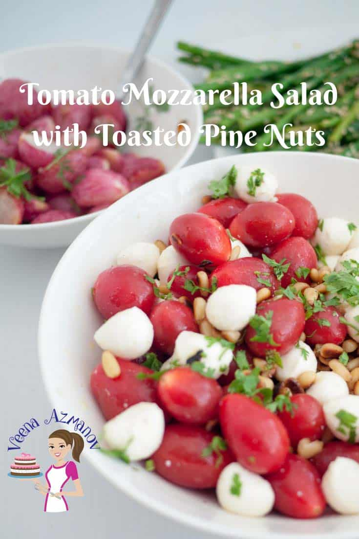 This tomato salad is a great twist on the Italian Classic Caprese Salad with toasted pine nuts. Simple, Easy and always refreshing this salad takes  less than five minutes to put together.