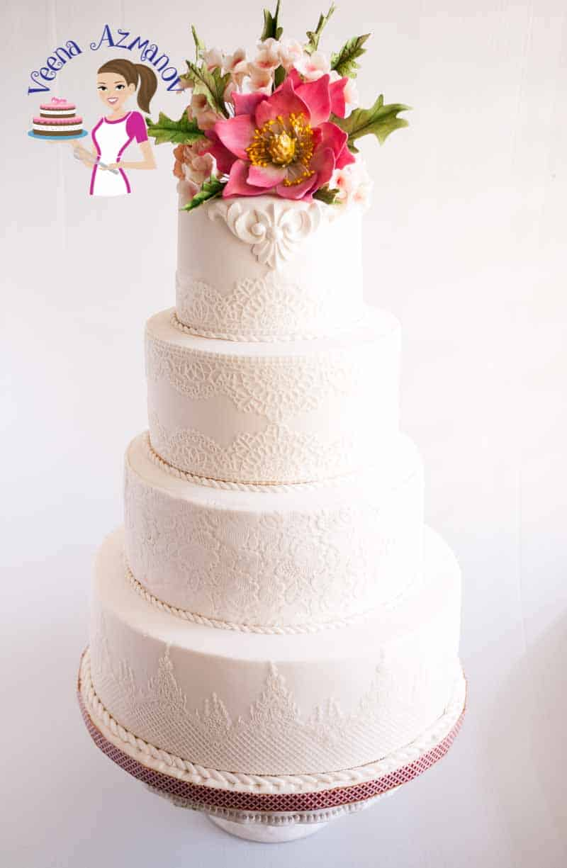Lace is now become a big trend in wedding cakes as you can see in this Lace white wedding cake; especially because of how delicate and elegant they look. I love making lace using my homemade edible sugar lace recipe. The option for lace mats can really be a big treat when you go shopping these days.