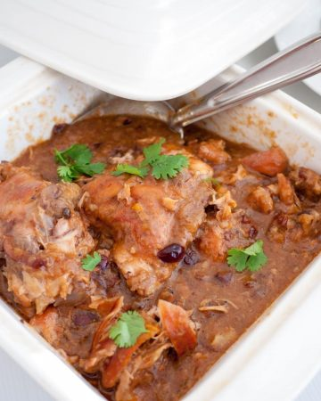 slow cooked apricot chicken in a serving dish.