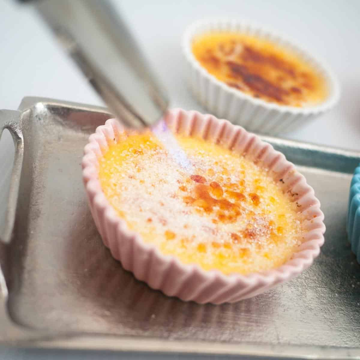 A blow torch flame over creme brulee.