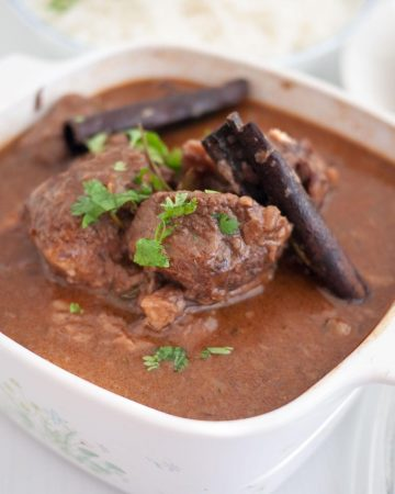 Slow cooked beef in a serving bowl.