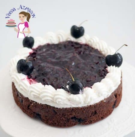 This moist chocolate cherry cake is an absolute cherry luxury. Baked with fresh cherries inside a moist chocolate cake. Topped with fresh whipped cream and more sweet homemade cherry filling. Drunken or not this cake is bound to intoxicate your senses.