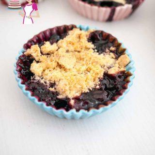 A blueberry crumble in a ramekin.