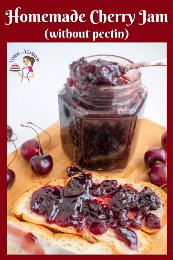 A jar of cherry jam and a piece of bread with jam.