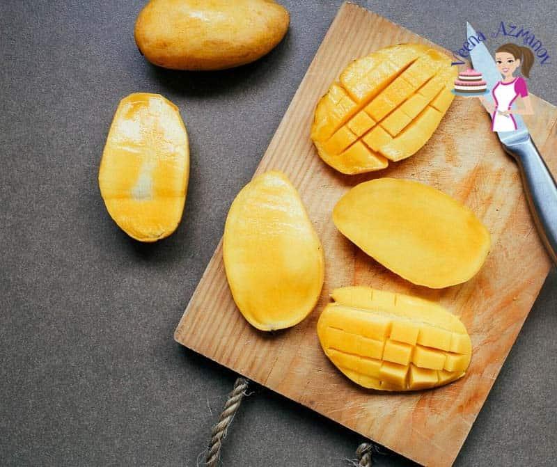A sliced mango on a cutting board.