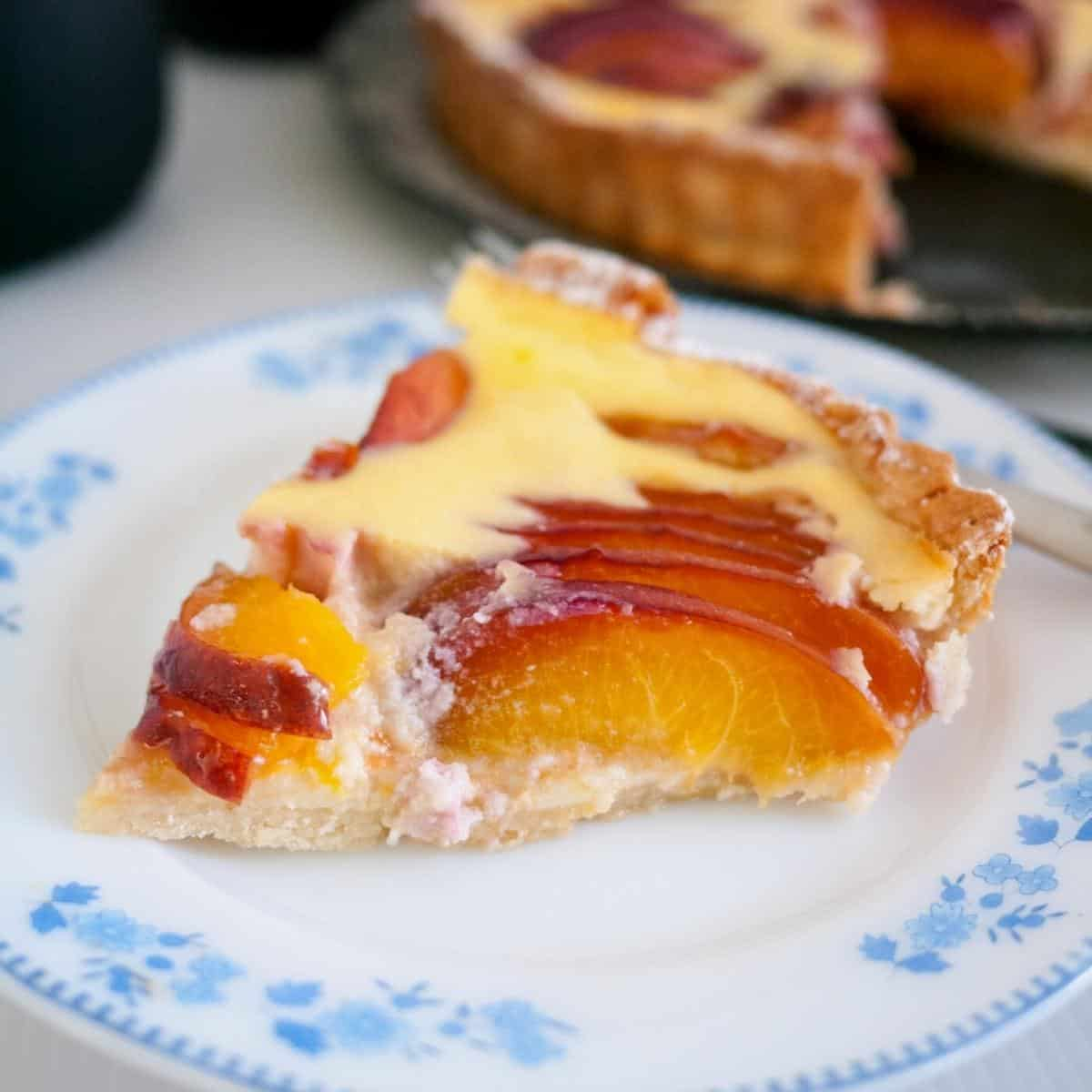 A slice of tart with nectarines.
