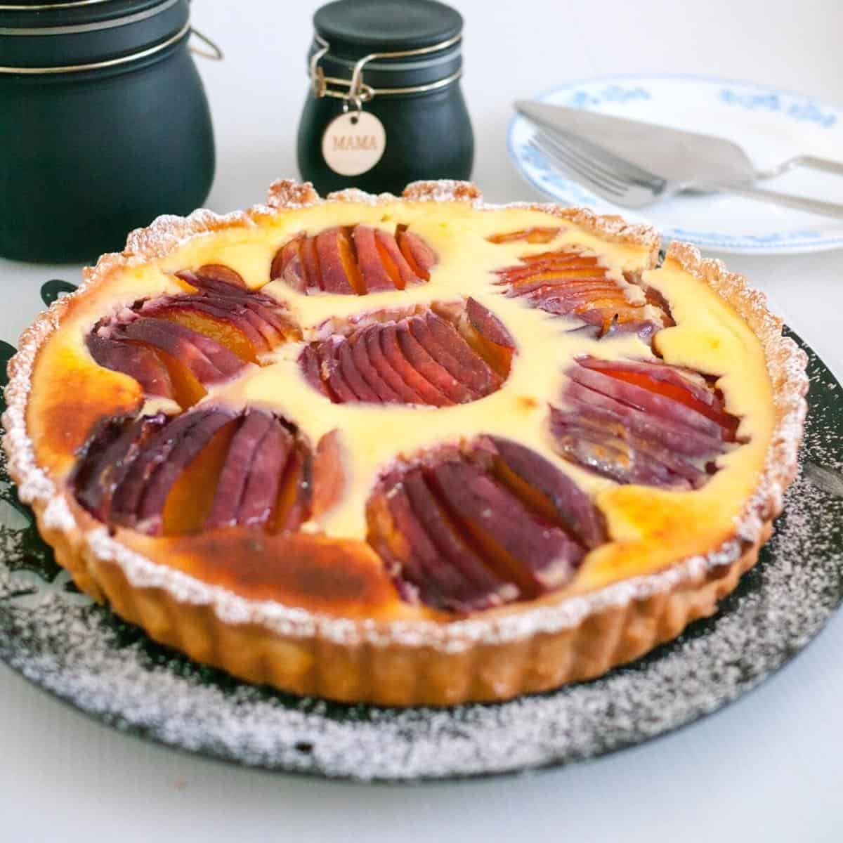 A tart with cream cheese filling and nectarines.