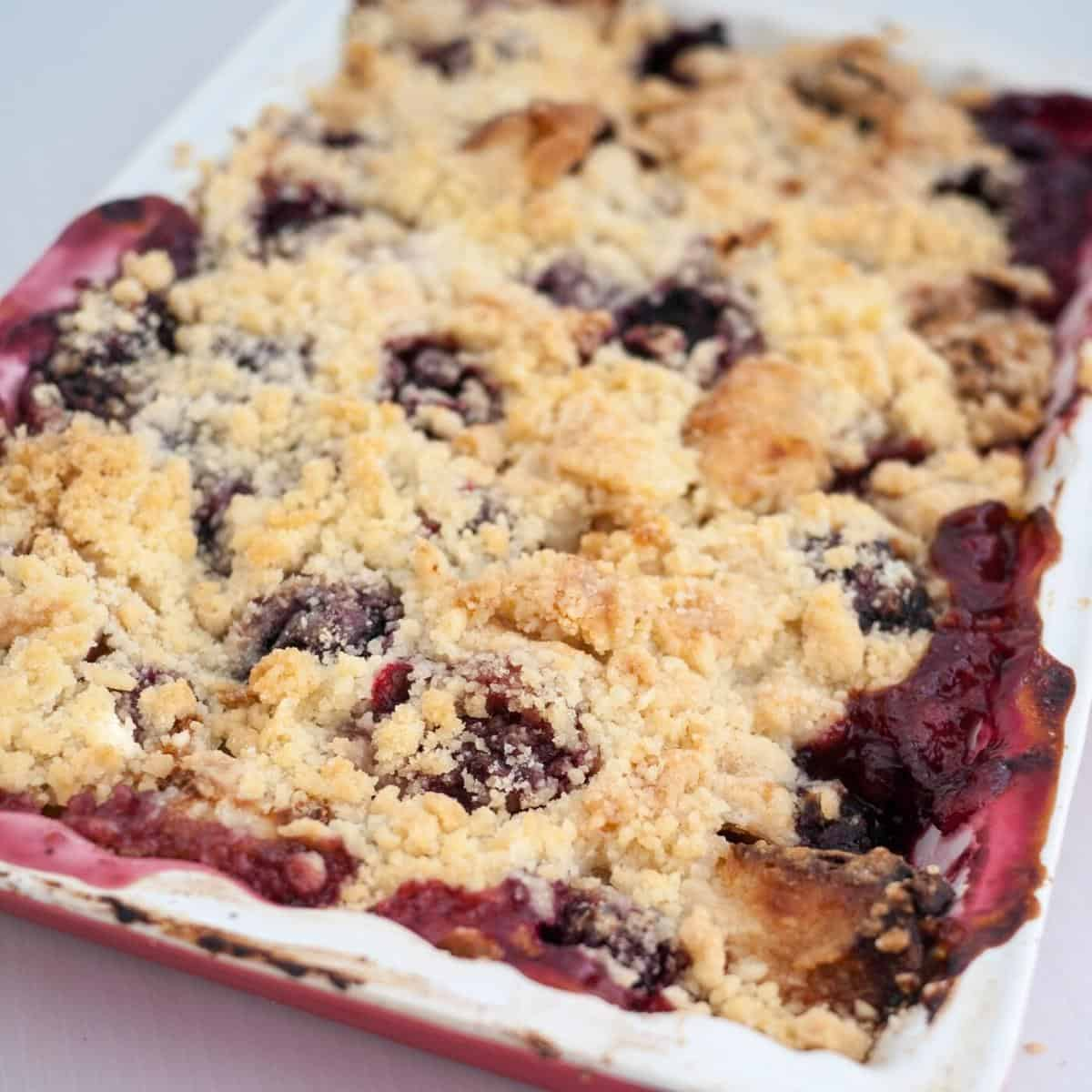 Baking tray with fruit crumble recipe.