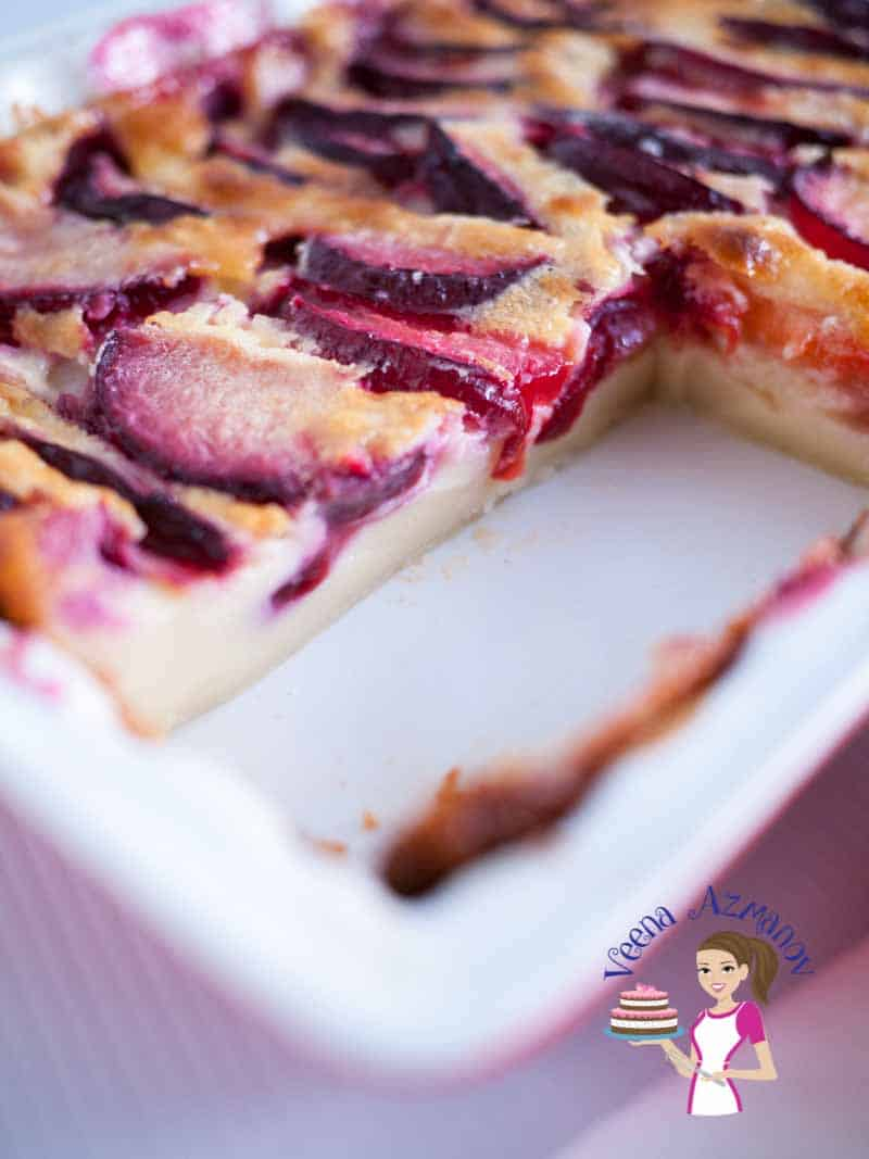 A close up of a sliced plum clafoutis.