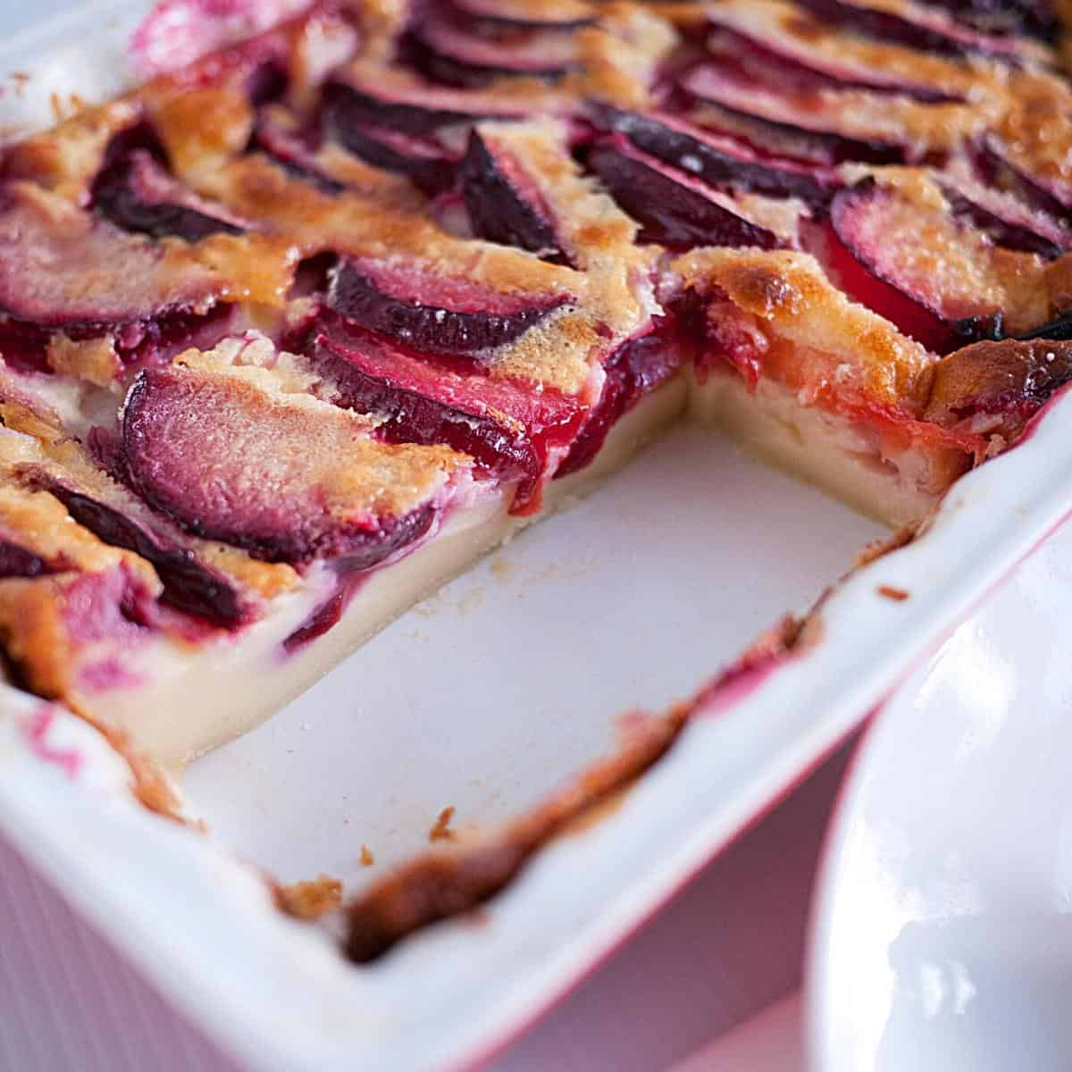 A sliced baking dish with clafoutis.