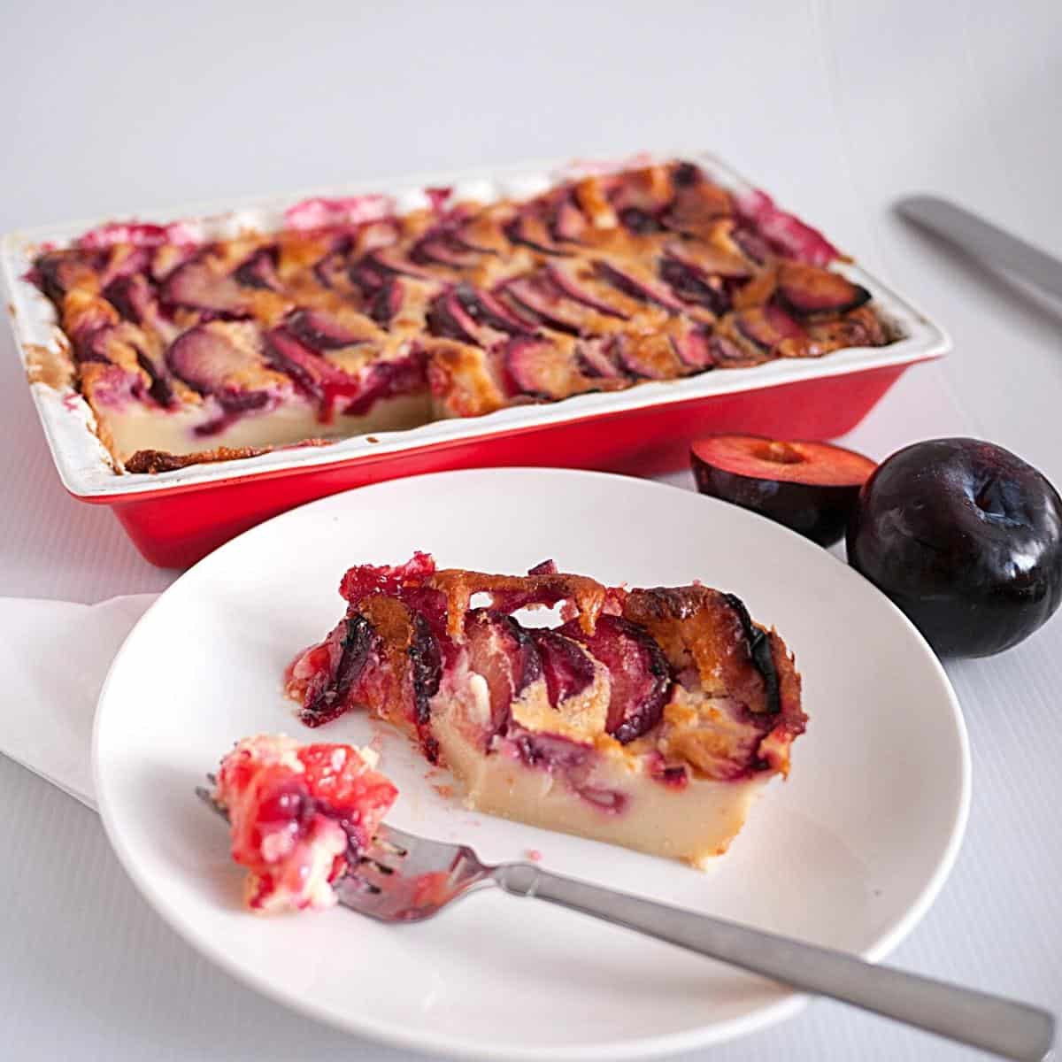 A slice of clafoutis with a fork.