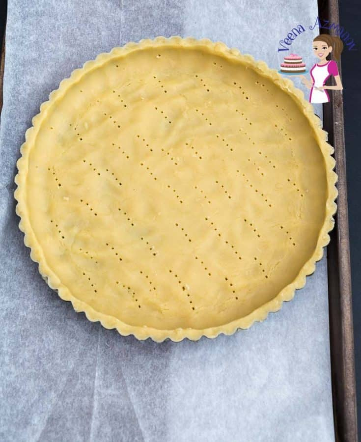 A tart crust on a baking tray.
