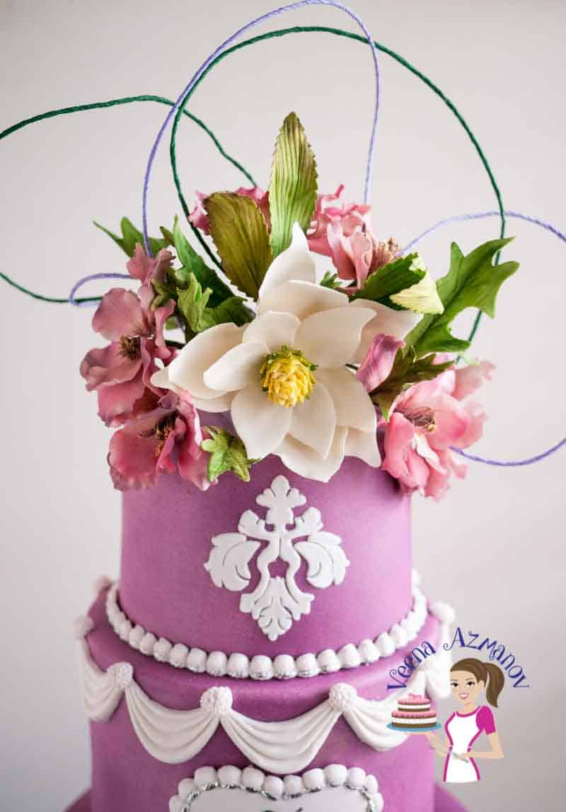 A bouquet of sugar flowers on a cake.