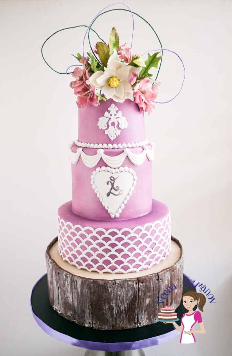 Violet Wedding Cake with Sugar Cosmos and Magnolia