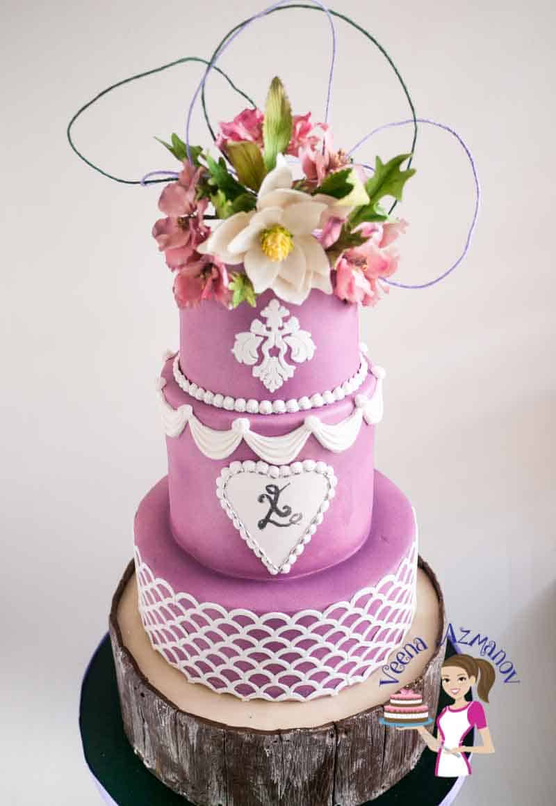 Violet Wedding Cake with Sugar Cosmos and Magnolia - Veena Azmanov