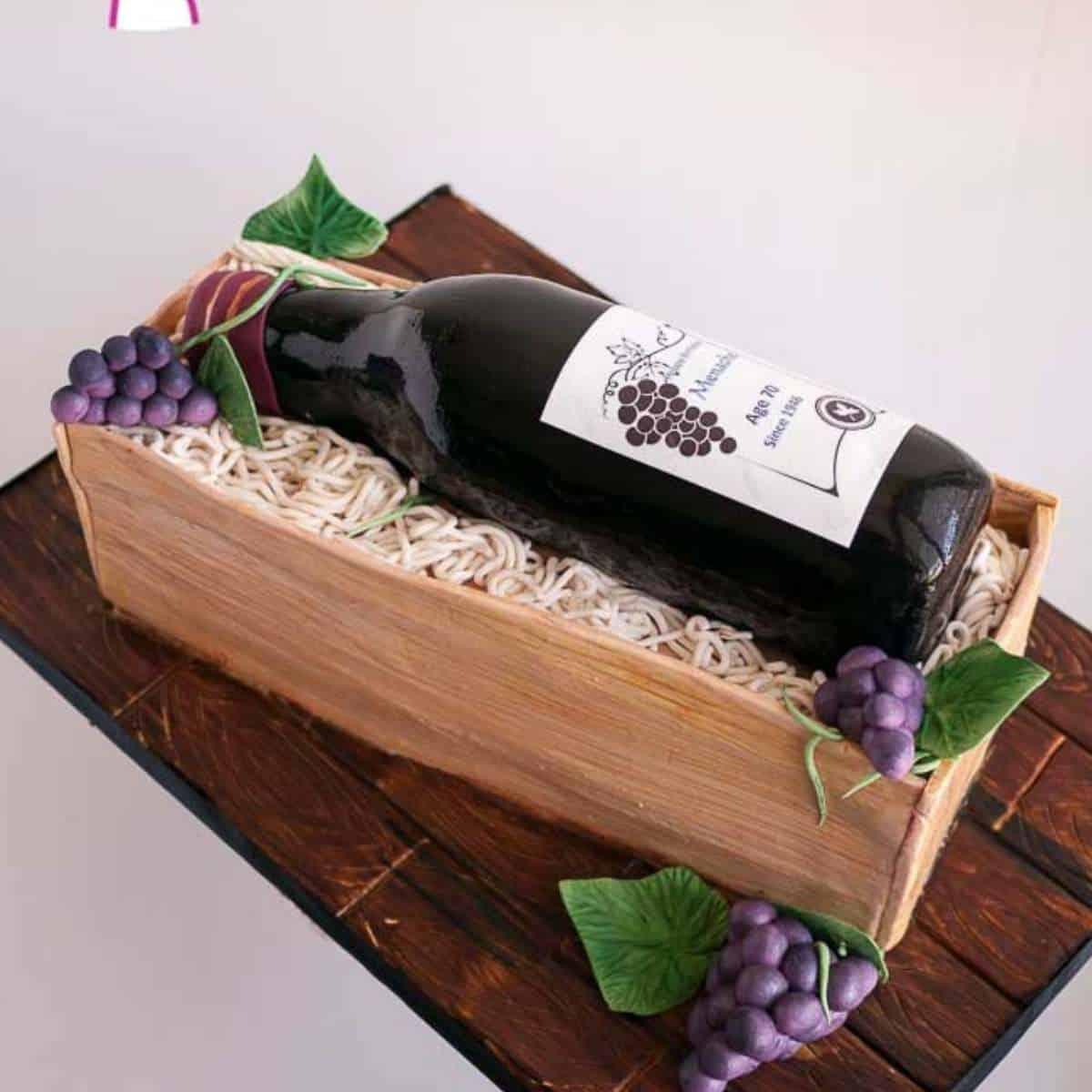 wine bottle cake on a cake board.