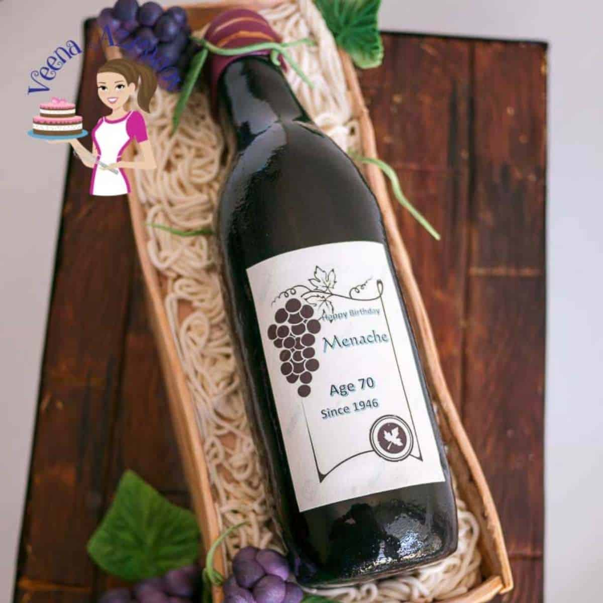 Fondant frosted novelty cake wine bottle in a crate on a cake board.