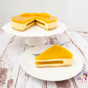 A slice of mango mousse cake on a plate.