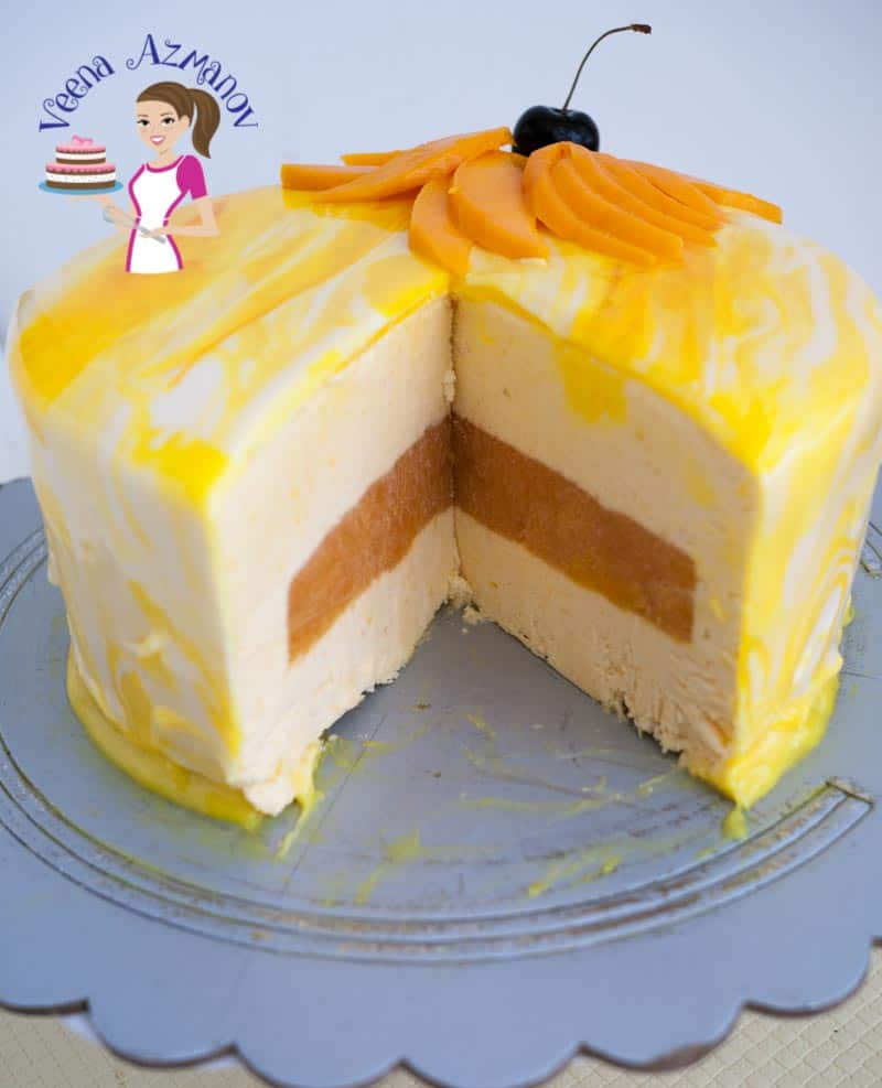 Delicious mango mousse cake with a mango jello center that just melts in the mouth. Glazed with a creamy mirror glaze for that ultimate smooth finish. A few extra steps in the making but still a simple, easy and effortless recipe with a very impressive show-stopper dessert.