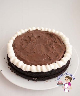 This moist eggless chocolate fudge cake has a firm texture with soft crumb that melts in the mouth. Simple and easy to make and so versatile with so many flavor variations. Try it with rich buttercream frosting, light whipped cream or fill it with an indulgent chocolate mousse filling like I have.