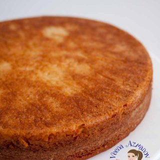 The Finished cake baked to golden brown of this eggless vanilla cake recipe