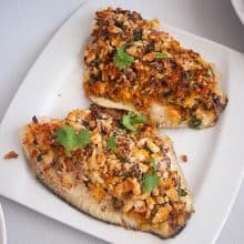 A plate with breadcrumb baked fish fillets.