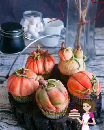 These pumpkin cupcakes are perfect treats to give as gifts to anyone big or small during the season of fall or Halloween. I've used my Pumpkin spiced apple cupcakes recipe and decorated them to look like pumpkins. They are simple easy and adorable as  you can see in the video tutorial.