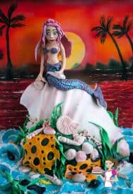 This Seashell Mermaid Sunset Cake was my Rhea's birthday cake. Here's more of the different elements on this cake; carving the cake, gumpaste coral and backdrop. An Ocean theme cake is perfect for any little girl celebrating her birthday.