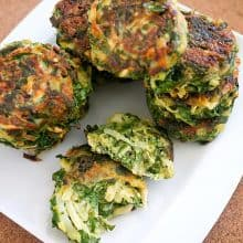 A white plate with vegetable patties.