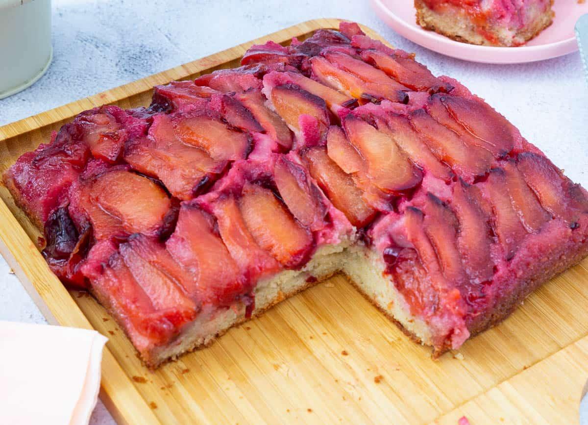 Plum cake on a cake board.