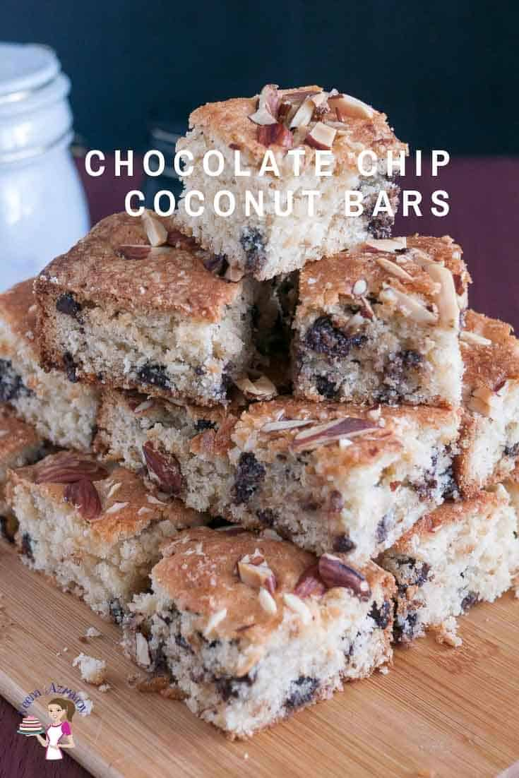 A stack of chocolate chip cake squares on a board.