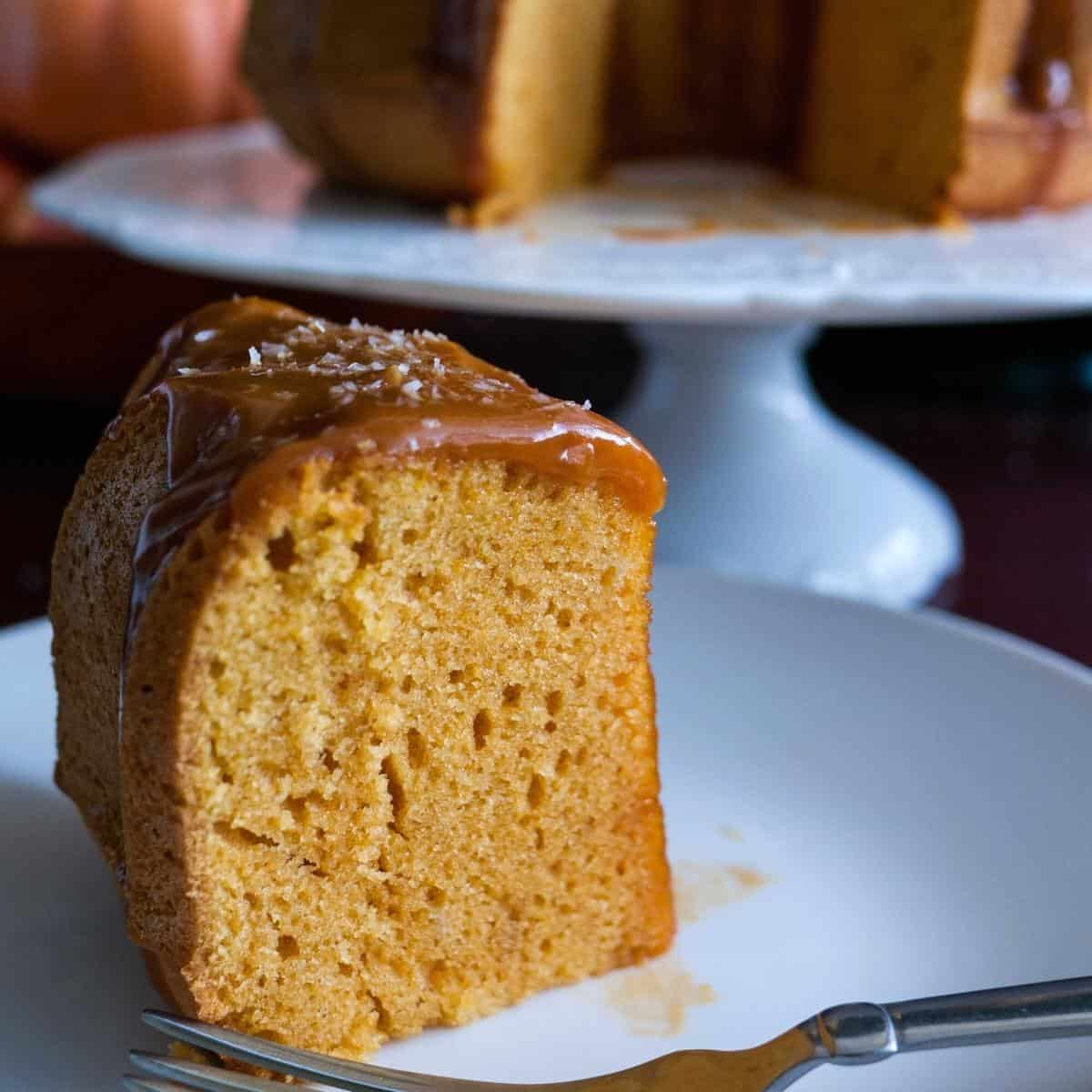 A slice of pumpkin bundt cake on a plate.