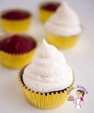A red velvet cupcake with cream cheese frosting.