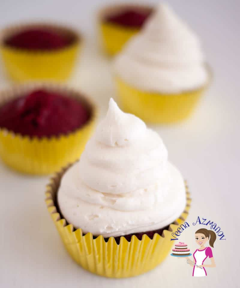 An image optimized for these moist red velvet cupcakes topped with no-butter cream cheese frosting. A simple, easy and effortless recipe that's light and fluffy.
