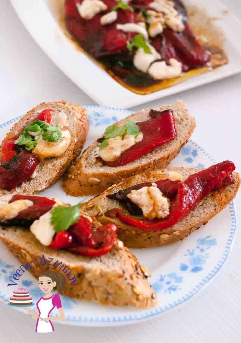 The slices of baguette toast with roasted red peppers and goats cheese crostini antipasti
