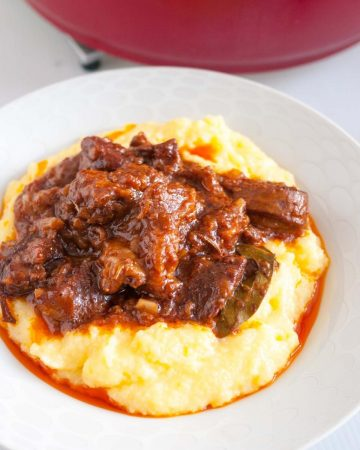 A plate of slow cooked lamb with polenta.