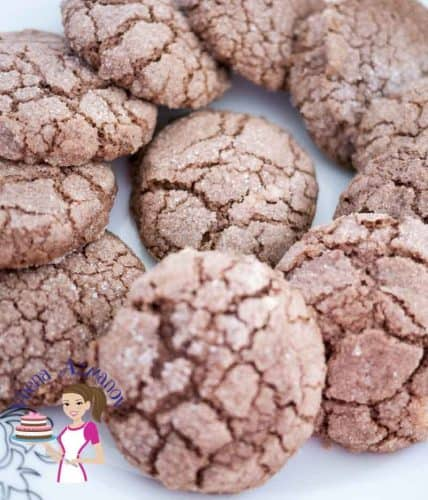 These chocolate crinkle cookies make perfect holiday cookies with added winter spices of ginger, cinnamon and cloves. Simple, easy and effortless recipe that gets done in 15 minutes weather you want them for an afternoon tea or put them in a jar as food gift ideas.