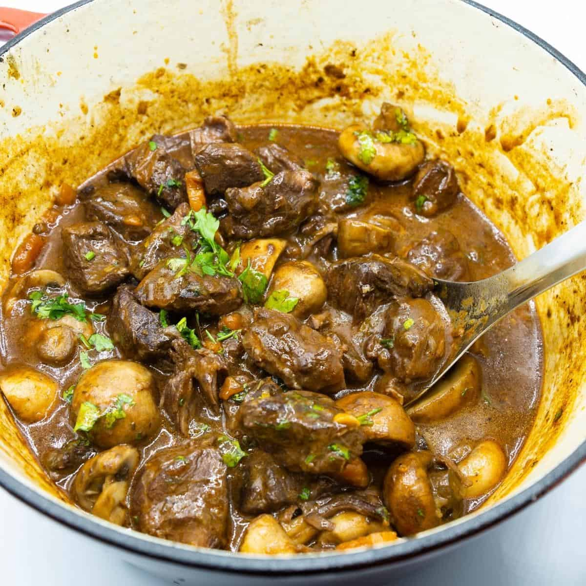A Dutch oven with beef bourguignon.