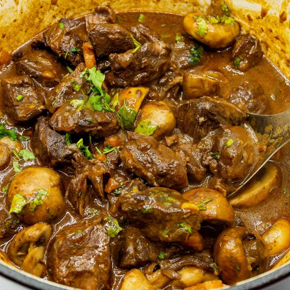 Beef burgundy in a Dutch oven.