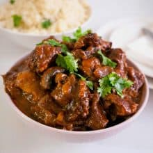 Beef burgundy in a serving bowl.
