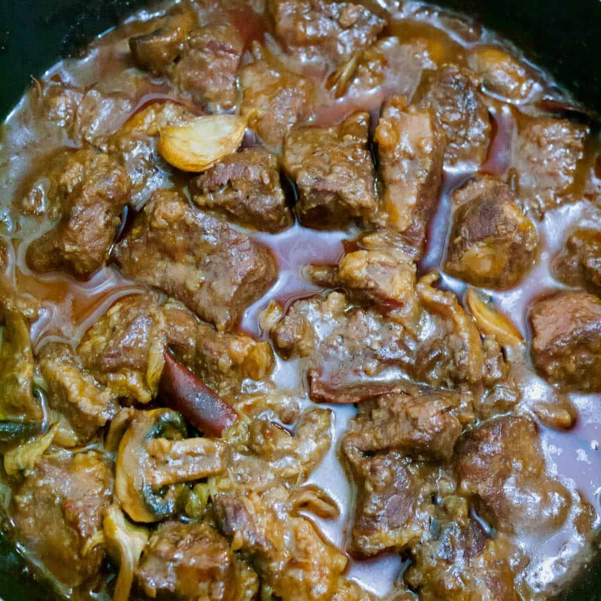 Beef burgundy in a slow cooker pot.