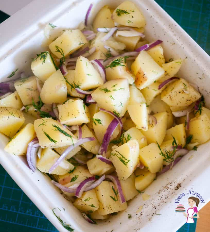 Add the potatoes to the onions marinade