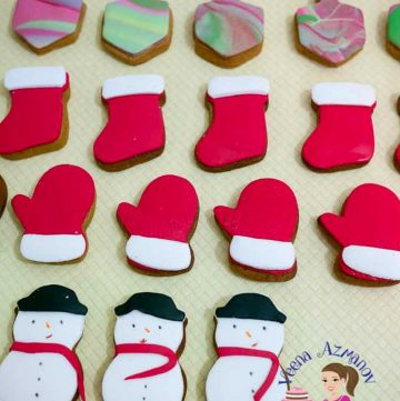fondant decorated sugar cookies on a table