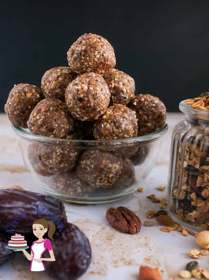 Dates energy bites in a glass bowl.