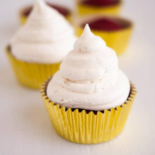 A cupcake with white frosting.